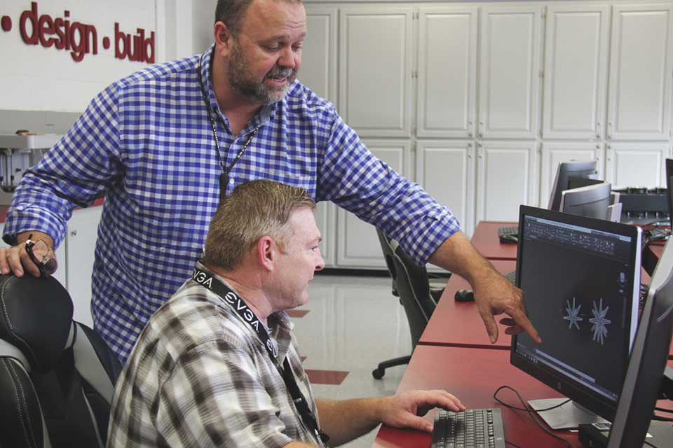 instructor with student at computer
